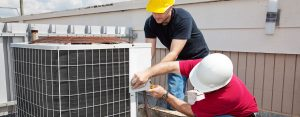men working on HVAC systems